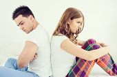 Upset Young Couple Having Marital Problems