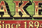 Old Grunge Wooden Boards with Painted Advertisement Letters