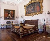 Mafra, Portugal - September 02, 2013: Kings Bedroom. Neoclassical bed and furniture. Mafra National