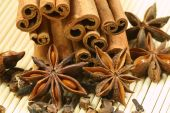 picture of ouzo  - Anise star cinnamon sticks and cloves on bamboo background - JPG