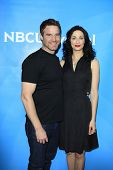 PASADENA - APR 8: Eddie McClintock, Joanne Kelly at the NBC/Universal's 2014 Summer Press Day held a