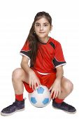 Girl In Complete Soccer Outfit Sitting On A Football