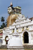 stock photo of vihara  - Head of Buddha and temple in Wewurukannala Vihara near Dikwella Sri Lanka - JPG