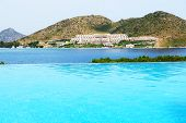 stock photo of infinity pool  - Infinity swimming pool at luxury hotel Bodrum Turkey - JPG