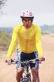 Close Up Face Of Young Man Riding Mountain Bike In Dusty Road Use For Bicycle Sport Out Door And Hum