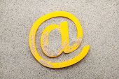 Yellow 3d email symbol in the sand