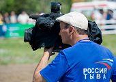 Television Cameraman Busy At Work