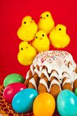 funny easter bread cake and colored egg with chickens on red background