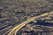 stock photo of tehran  - Aerial view of Tehran with a main highway lit under sunlight - JPG