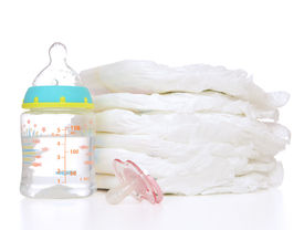 picture of nipples  - New born child stack of diapers nipple soother baby feeding milk bottle with water on a white background  - JPG