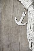 Maritime background - Harbour - anchor and rope