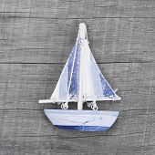 Sailing boat decoration on the wooden background