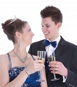 Carnival: young couple isolated on white drinking champagne