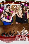 Happy gorgeous women having hen party against christmas frame