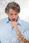 Composite image of tanned man having a coughing fit against snowflakes on silver