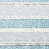 Ivory Lace Fabric On Blue Background