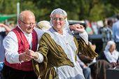 Eldery Man And Woman Demonstrating An Old Dutch Folk Dance During A Dutch Festival