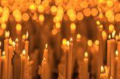 burning orange candles close up