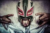 Rock and roll, aggressive executive suit and tie, Mexican wrestler mask