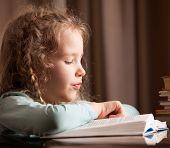 Girl reading book. Child education