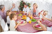 Family having christmas dinner against fir tree forest and snowflakes