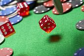 roll of the dice on a game table in a casino, motion blur