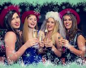 Laughing friends clinking champagne glasses at a hen night against snow flake frame in green