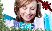 Beautiful woman with shopping bags against red christmas bow and ribbon