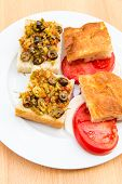Preparing Vegetarian Sandwiches With Pickle Muffaletta, Tomatoes And Mozzarella Cheese.