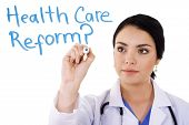 image of health-care  - Stock image of female doctor writing on whiteboard - JPG