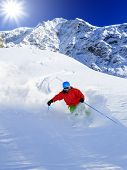 Ski, winter sport - freeride in fresh powder snow