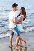Summer, sea. Cute, lovely couple on the beach
