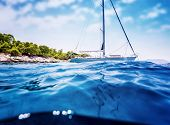 Luxury sailboat anchored near tropical island, amazing cruise along Greece, unforgettable summertime