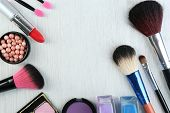 stock photo of cosmetic products  - Beautiful decorative cosmetics and makeup brushes - JPG
