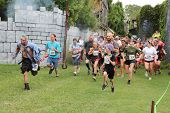 MUSKOGEE, OK - Sept. 13: Runners start at a difficult zombie-infested course during the Castle Zombie Run at the Castle of Muskogee in Muskogee, OK on September 13, 2014.