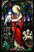 picture of the lost sheep  - Jesus the good shepherd with lambs - stained glass window in old stone church in Kilauea Kauai
