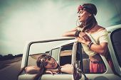 stock photo of road trip  - Hippie girls in a minivan on a road trip - JPG