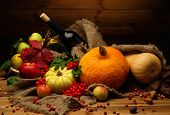 stock photo of thanksgiving  - Thanksgiving day autumnal still life with bottle of wine  - JPG