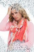 Woman having both headache and belly pain against snowflakes on silver