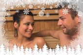 Cheerful couple relaxing in a sauna and chatting against fir tree forest and snowflakes