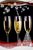 Christmas frame showing two full glasses of champagne and one being filled