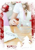 Portrait of a cute woman preparing a meal in the kitchen against christmas themed frame