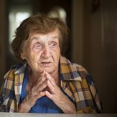 Old restless emotional woman during a conversation, close-up portrait.
