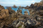 Sharp rocky coastline in the Ushant island (aka Ouessant), Brittany, France