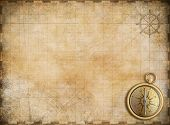 stock photo of primitive  - old map with brass compass as exploration and adventure background - JPG