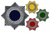 Metal Badges In Different Colors On White Background