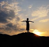 Silhouette Of Young Person On Mountain