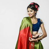 Young beautiful brunette woman in indian green dress