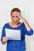 a young woman gets bad news in a letter in the mail