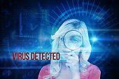 The word virus detected and fair-haired woman looking through a magnifying glass against blue technology interface with dial